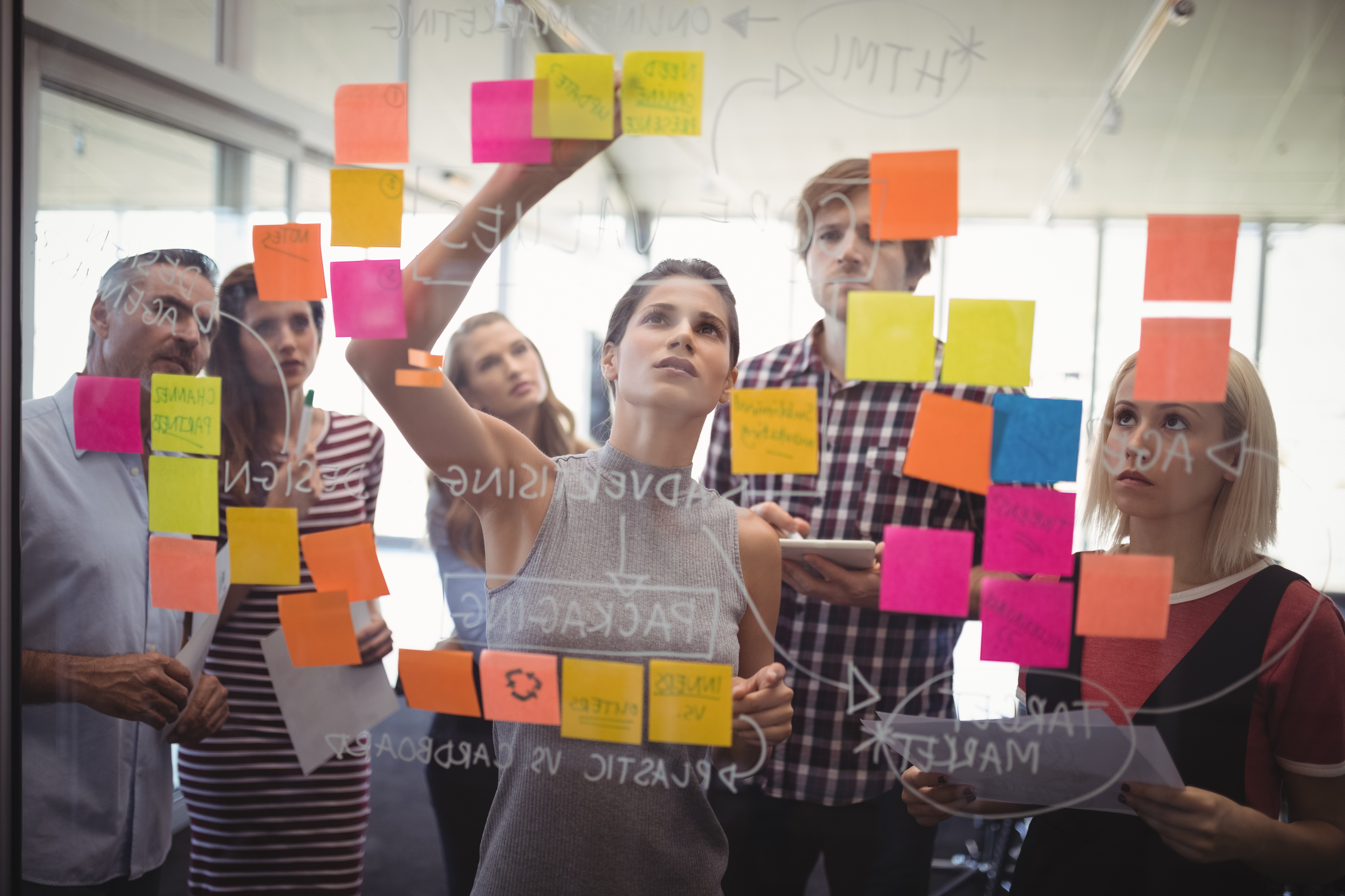 Group of people brainstorming with sticky notes