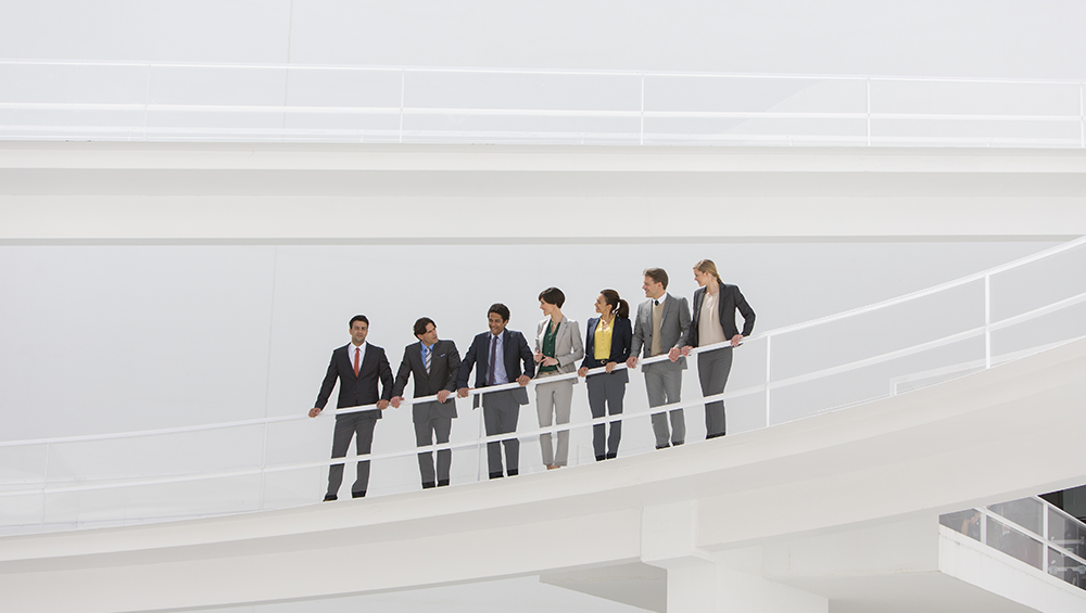 business people on a bridge