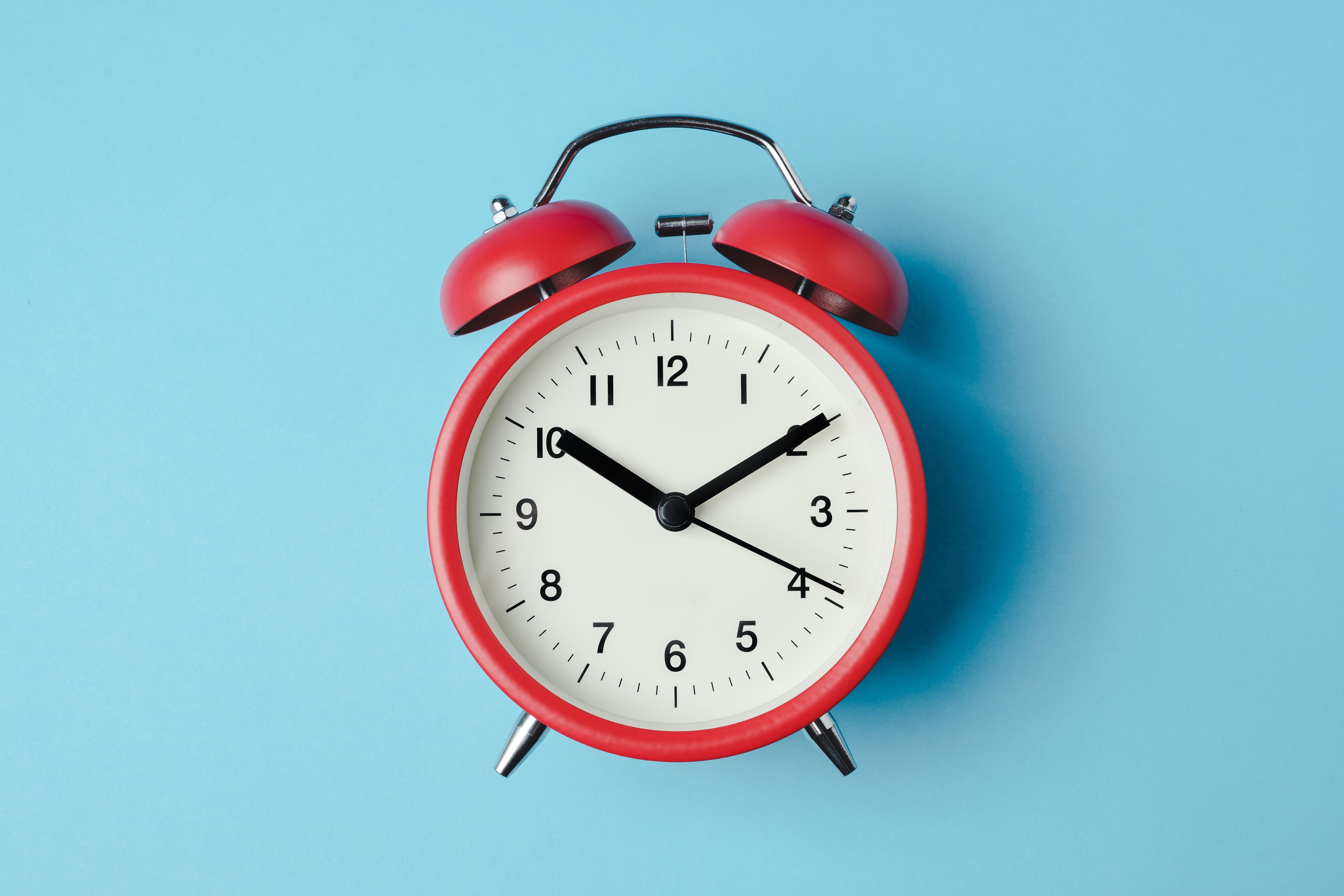 Red clock against blue background